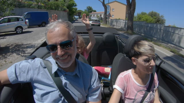 Family Enjoying a road trip with a Convertible car