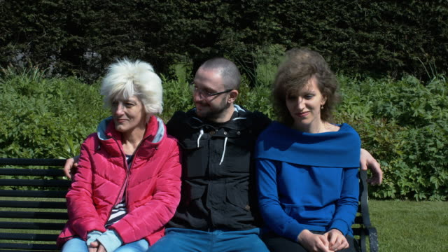 A Family Enjoying A Sunny Day In The Park video