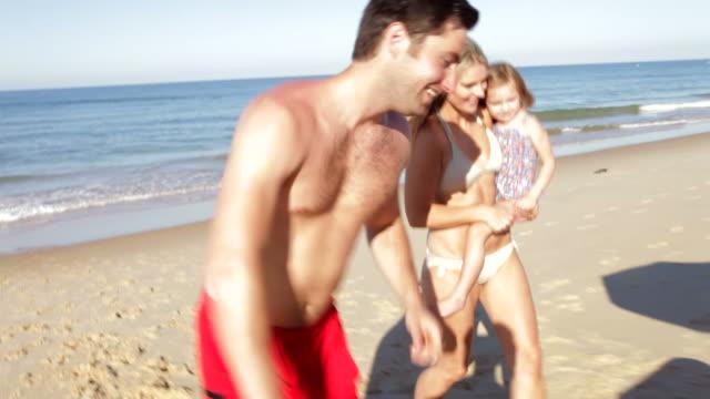 Family Enjoying Beach Holiday Together