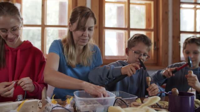 Family enjoying crafting, carpentry and carving wood