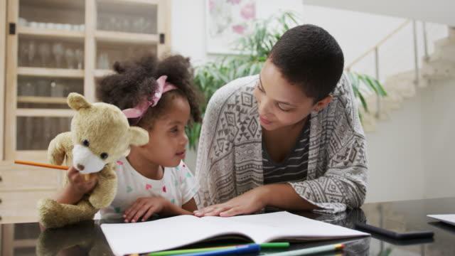 vídeos de stock e filmes b-roll de family enjoying free time at home - teddy bear