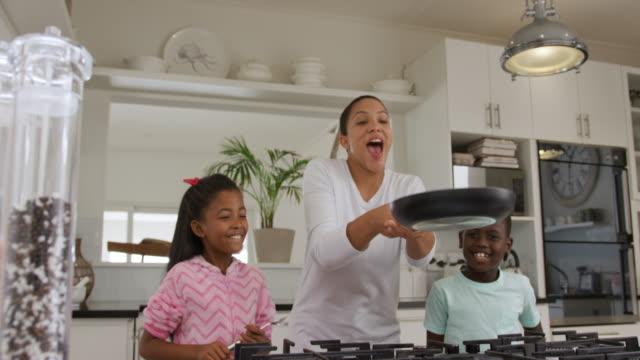 family enjoying free time at home - сковорода стоковые видео и кадры b-roll