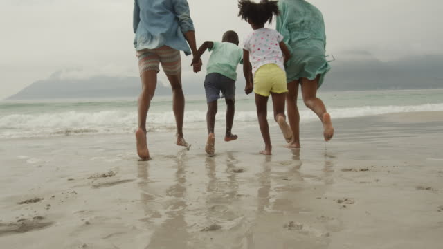 Family enjoying free time by the sea