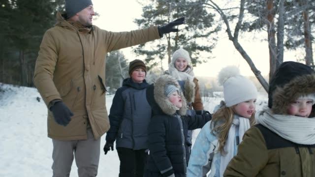 Family Enjoying Nature Walk in Winter