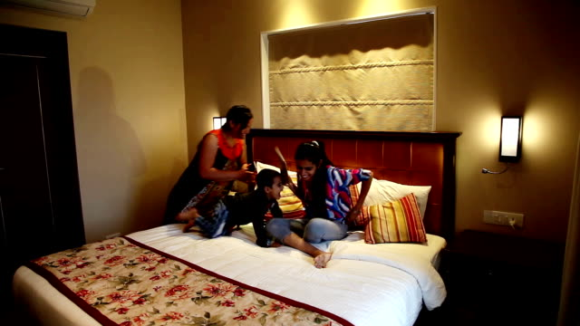 Family enjoying on vacations Family enjoying on vacations at hotel room. indian family stock videos & royalty-free footage