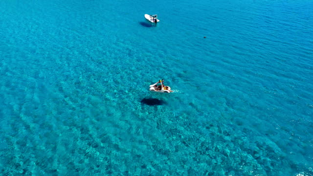 Family enjoying swimming in a blue tropical sea video