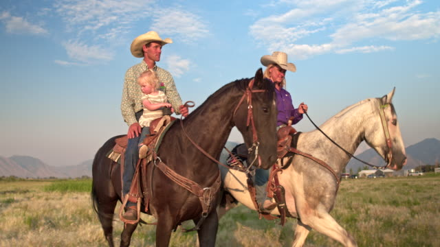 Family enjoying the day horseback riding in the fields Real time video of family enjoying the day horseback riding in the fields. rancher stock videos & royalty-free footage