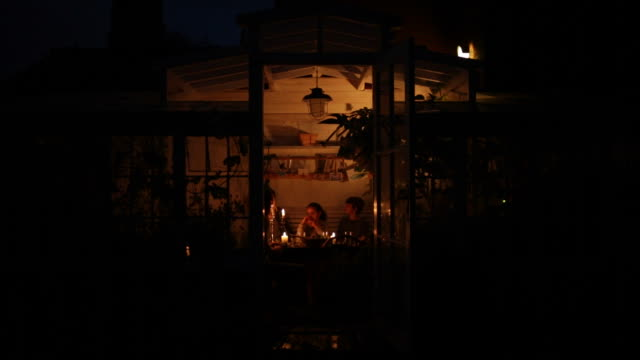 Family gathered around table with candlelights video