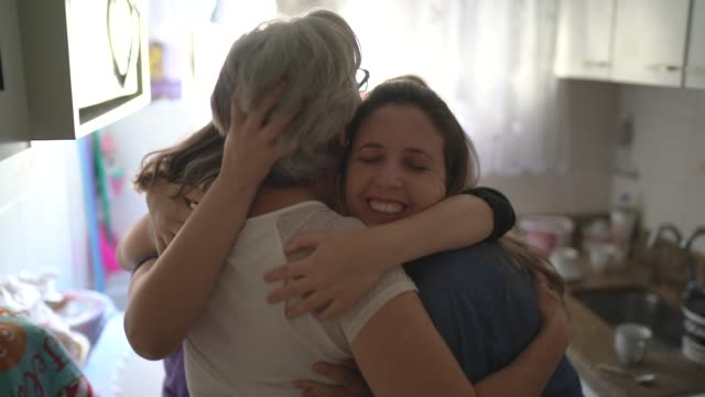 Family girls embracing at home Family girls embracing at home mothers day stock videos & royalty-free footage