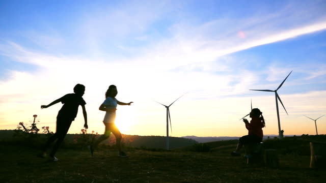HD SLOW MOTION: Family Happy at hill with sunset HD SLOW MOTION: Family Happy at hill with sunset wind power stock videos & royalty-free footage