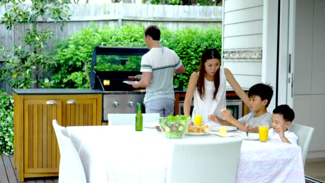 family have lunch on terrace - kitchen situations video stock e b–roll