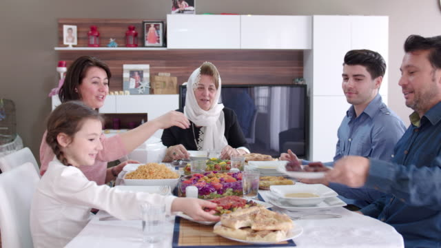 family having an iftar meal - ramadan stock videos and b-roll footage