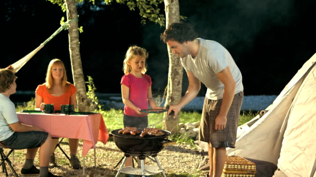 Family Having Barbecue At Campsite video