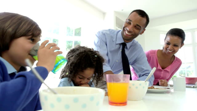 Family Having Breakfast Before Husband Goes To Work video