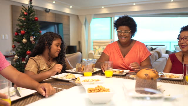 family having dinner at christmas - panettone video stock e b–roll