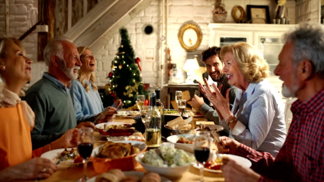 family having dinner on christmas eve. - cena natale video stock e b–roll