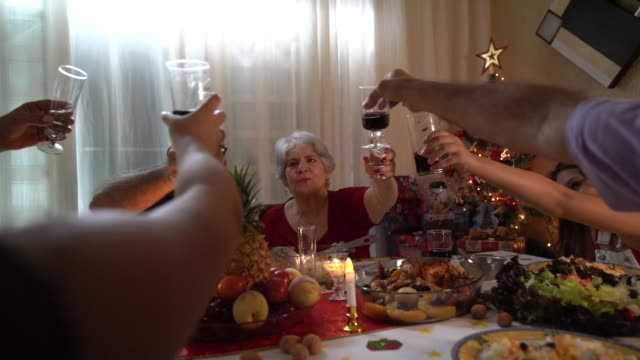 Family Having Dinner Together Celebrating Christmas Time