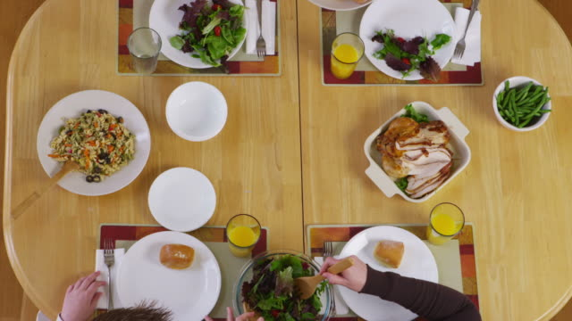 Family having dinner together, overhead view video