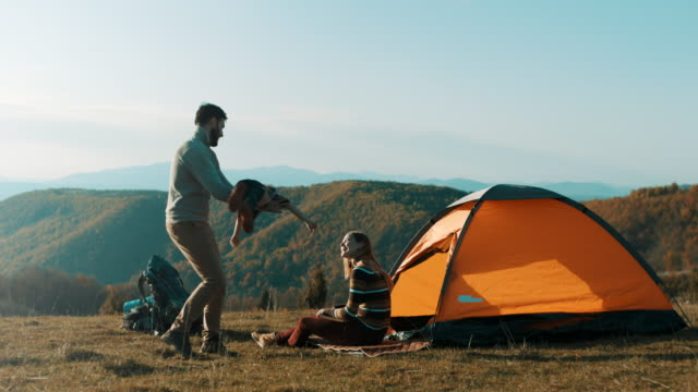 family having fun on camping trip - campeggio video stock e b–roll
