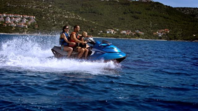 SLO MO Family Having Fun Riding A Jet Boat video