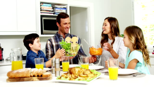 Family having healthy meal together at home video