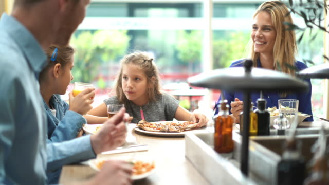 Family having lunch at a restaurant.