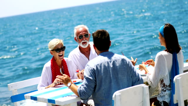 vídeos de stock e filmes b-roll de family having lunch outdoors. - enjoying wealthy life