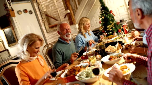 family having thanksgiving dinner. - christmas table video stock e b–roll
