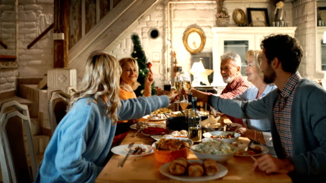 family having thanksgiving dinner. - cena natale video stock e b–roll