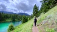 istock Family Hiking at Valley of the Five Lakes Trail, Jasper, Canada 1280362105