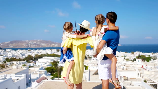 Family in Europe. Parents and kids background the old town in Mykonos island, Greece video