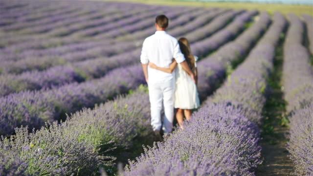 family in lavender flowers field at sunset - wschodnio europejski filmów i materiałów b-roll