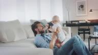 istock Family in living room 587160926