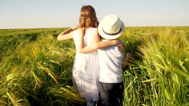 Family in wheat field video