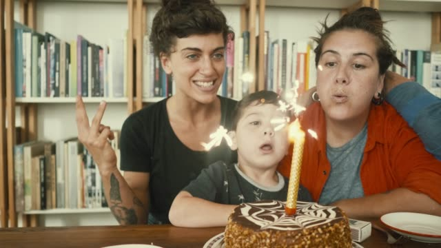 lgbt family is having a birthday (slow motion) - coppia gay video stock e b–roll