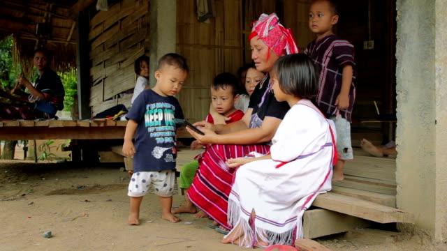 stockvideo's en b-roll-footage met family karen enjoys learning to use a digital tablet - oost aziatische cultuur