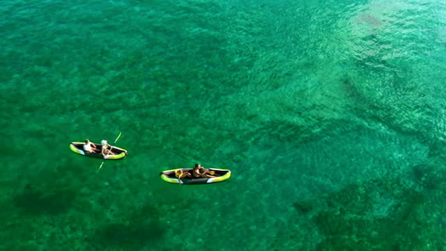AERIAL Family Kayaking In The Shallow Water video