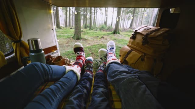 Family laying in camper van in Christmas socks Family with little boy laying in camper van in Christmas socks rv interior stock videos & royalty-free footage