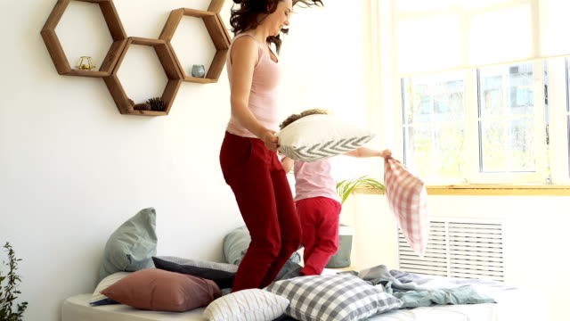 family, mother and daughter. pillow fight - pillow stock videos & royalty-free footage