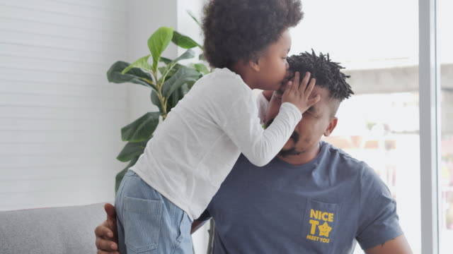 family of african father with little boy spending time together to kissing tenderness at home.dad and child tender moments.father, father's day, celebration, togetherness, bonding, admiration, love-emotion, family, single father - sostegno emotivo video stock e b–roll