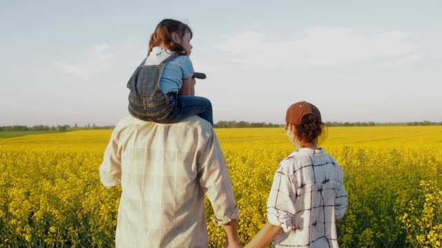 a family of farmers in the field. farmers are happy with the harvest. - canola video stock e b–roll