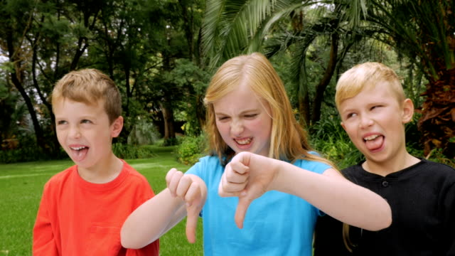 A family of three children expressing yuck and giving thumbs down video