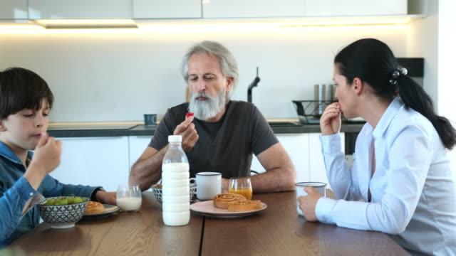 Family of Three Enjoying Weekday Breakfast Together video