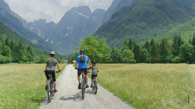 CS Family of three with a young son talking while starting their bike trip into the mountains video