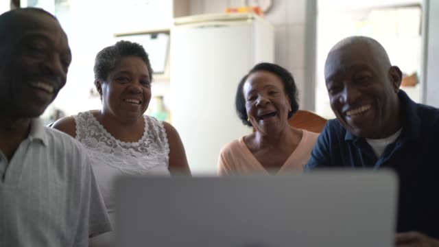 family on a video calling using laptop at home - video call with family stock videos & royalty-free footage