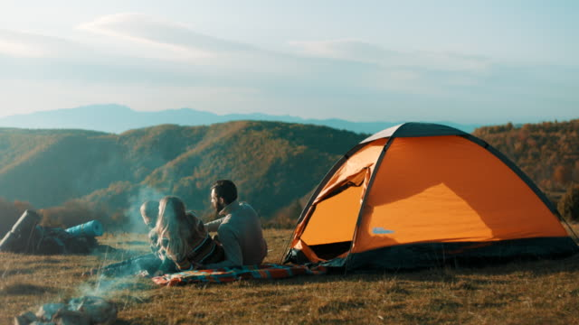 Family on camping trip on mountain video