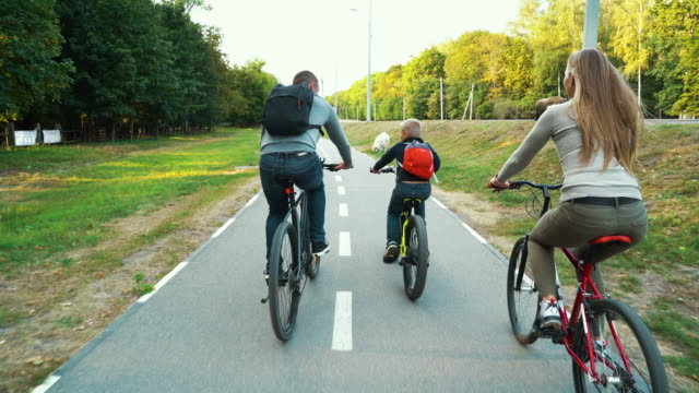 Family on cycle ride in country video