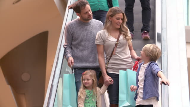 Family On Escalator In Shopping Mall Together video