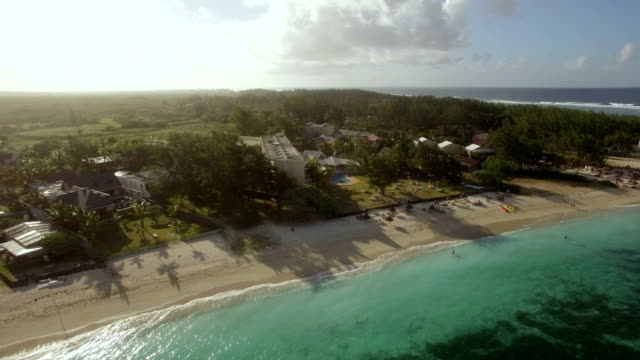 family on resort and mauritius aerial view - isole mauritius video stock e b–roll