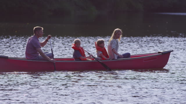 Family paddling canoe video